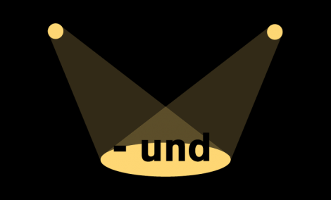 The word und under two spotlights